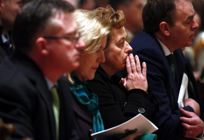 Irish dignitaries pray during Mass.