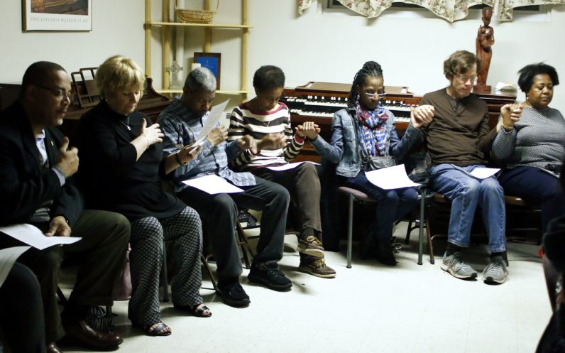 Catholics from several archdiocesan parishes pray together during a discussion on race Feb. 28 at St. Raymond Parish, Philadelphia. (Sarah Webb)