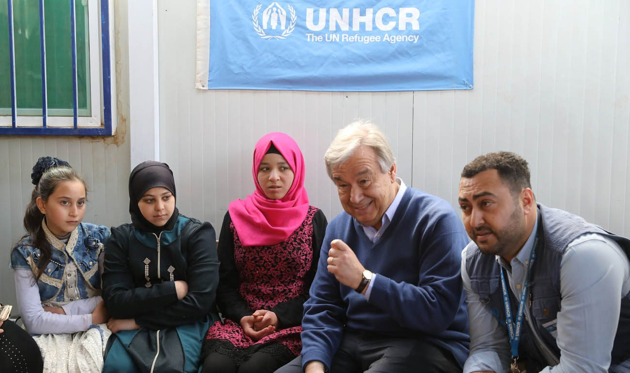 U.N. Secretary-General Antonio Guterres gestures as he visits with Syrian refugees March 28 at Zaatari camp near Mafraq, Jordan. As the Catholic secretary-general visited the world's biggest camp for Syrian refugees, he made an impassioned plea: Stop Syria's devastating war. (CNS photo/Ammar Awad, Reuters)