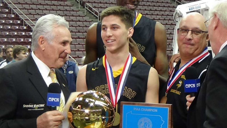 Collin Gillespie wraps up one of many media interviews aftewr the PIAA Class 5A championship victory March 24 in Hershey, Pa. Alongside Gillespie is Archbishop Wood coach John Mosco. John Knebels)