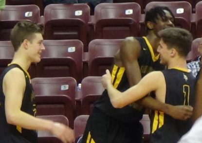 The last of the Archbishop Wood starters in the PIAA championship game, senior Collin Gillespie (right), comes off the court as he gets congratulations from xx near the end of the game. (John Knebels)