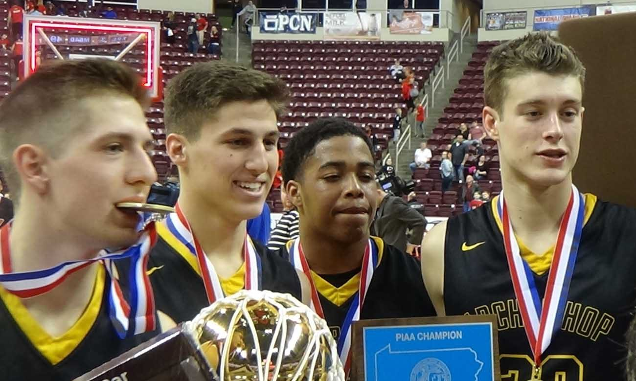 Archbishop Wood's boys basketball team, led by senior Collin Gillespie (second from left), enjoy their PIAA Class 5A state championship March 24 in Hershey, Pa. (Photo by John Knebels)