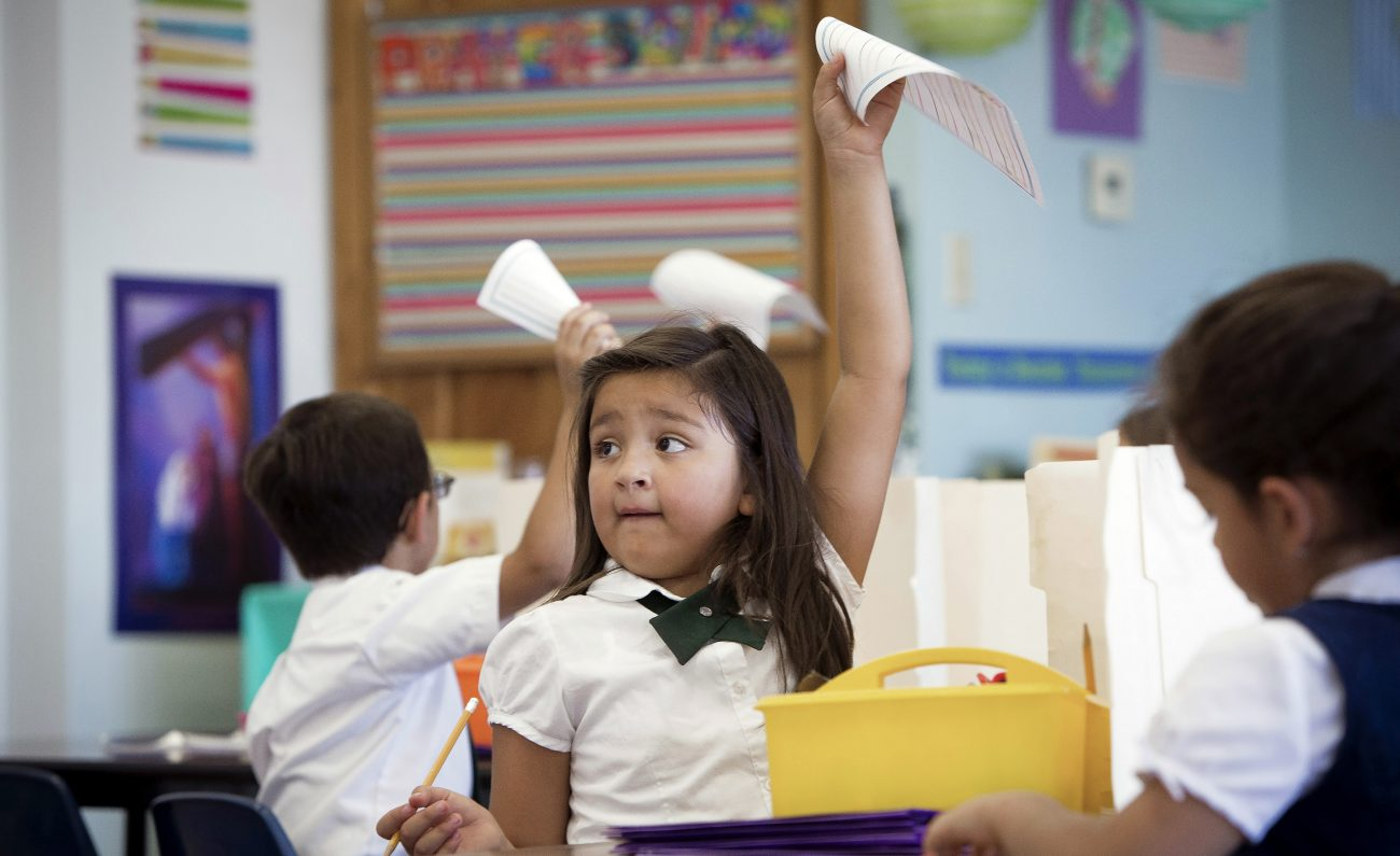 First-grade students finish an assignment at St. Ambrose Catholic School in Tucson, Ariz., in this 2014 photo. Arizona will expanded its school choice program to all students by 2021. (CNS file photo/Nancy Wiechec)