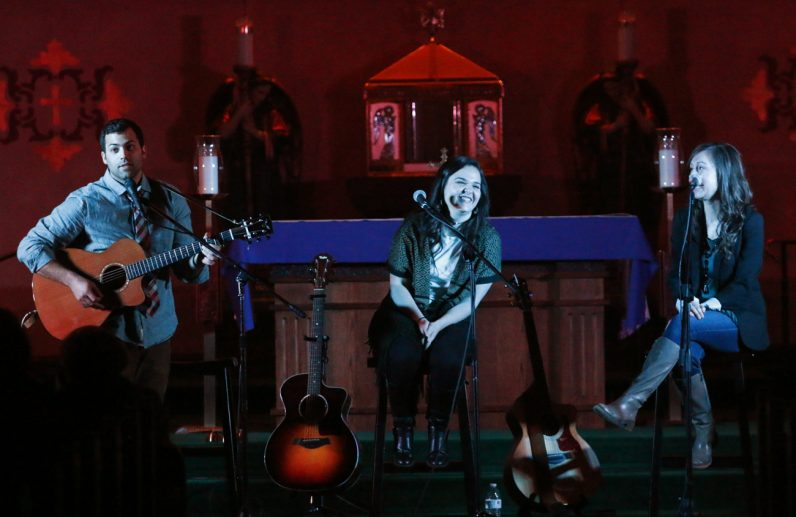 Luke Spehar, Dana Catherine, and Teresa Peterson perform in the sanctuary at Nativity of Our Lord.