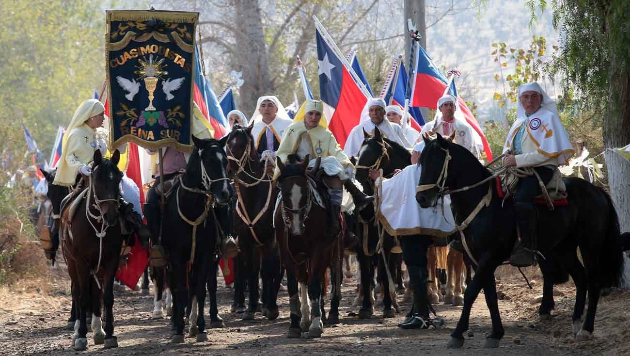 Volunteers dressed in traditional cowboy clothing carry a banner and Chilean flags during the Quasimodo Festival in Colina, Chile, April 23, Divine Mercy Sunday. (CNS photo/courtesy Santiago Archbishop's Office)