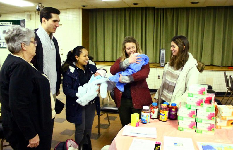 Sr Sarah Lodge, RSM, Francisco Lopez (fellow at St Joseph University), Maricela Valerio, Jenny Schadt (senior fellow at St Joseph University), and Beztriz Torre (junior fellow at St Joseph University) get a chance to meet Maricela's twins Catalella and Allison and talk to her about infant care.