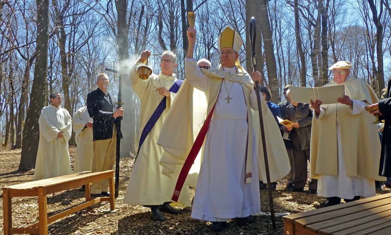 Norbertine Abbot Richard Antonucci formally blesses the new meditation garden featuring the Stations of the Cross at Daylesford Abbey, Paoli, on April 8.