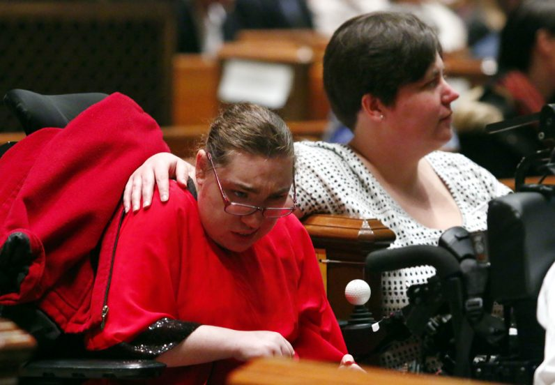 Megan and Jessica Fisher from St. Edmond's Home attend the Mass for persons with disabilities.