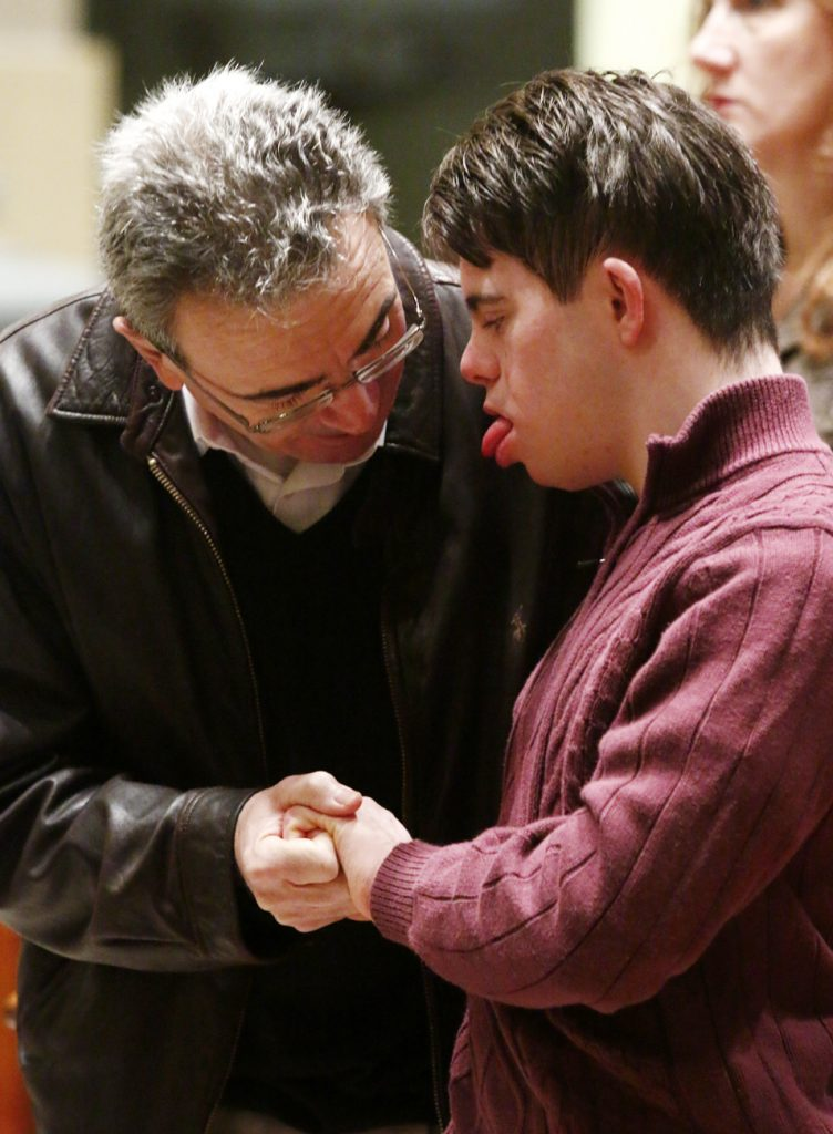 Michael (left) and Dave Malloy from St. Anastasia Parish in Newtown Square attend the annual Mass for Persons with Disabilities April 1 at the Cathedral Basilica of SS. Peter and Paul.