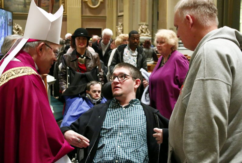 William and Larry Mensch from Our Lady of Ransom Parish, Philadelphia, chat with Archbishop Chaput after Mass.