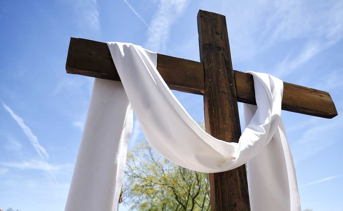 In this April 30, 2015, file photo, a cross draped with a white sash for Easter is seen on the campus of St. Peter Indian Mission School in Bapchule, Ariz. Easter, the feast of the Resurrection, is March 27 this year. (CNS photo/Nancy Wiechec)