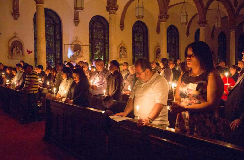 Catechumens and others attend the Easter Vigil March 26 at St. Paul Church in Wilmington, Del. (CNS photo/Octavio Duran)