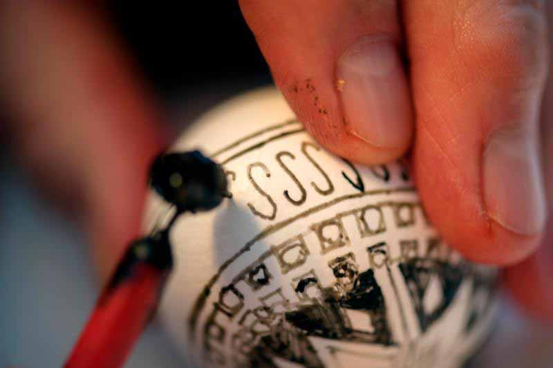 David Bryniarski, a parishioner of St. Stanislaus Kostka Church in Rochester, N.Y., uses a fine writing stylus to draw a design on an egg Feb. 24, 2016. Catholics can offer their children fun ways through Easter crafts to find a connection with their faith. (CNS photo/Mike Crupi, Catholic Courier)