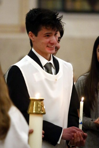 Andrew Carpenter, from Archbishop Carroll High School, is all smiles after being baptized into the Christian faith at Sacred Heart Church, Havertown. (Sarah Webb)