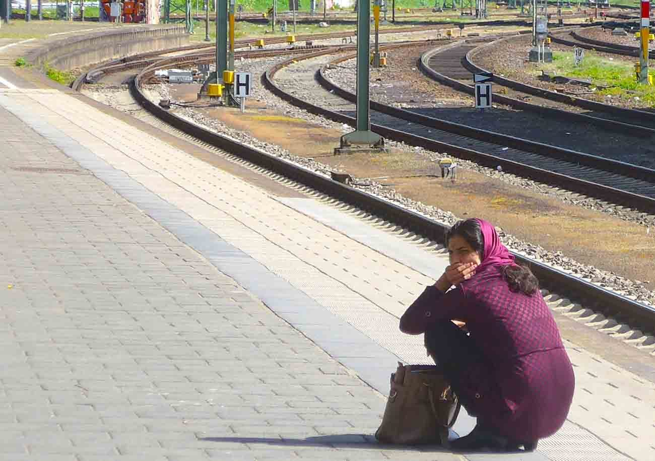 A Muslim refugee woman waits for a train April 11 in Heidelberg, Germany. Amid rising social unrest and an influx of Mideast migrants, German authorities, including church officials, are facing criticisms from ordinary people who believe their concerns are being ignored. (CNS photo/Zita Fletcher)