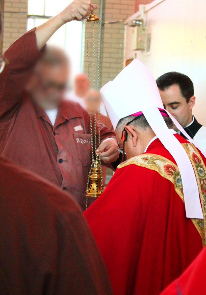 Inmates serve Mass at SCI Graterford at which Archbishop Charles Chaput was the celebrant on Saturday, April 8.