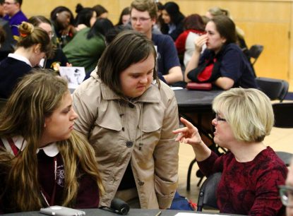 Dr. Karen Gaffney chats with students students attending the High School Respect Life Conference and Rally April 6 at Neumann University.