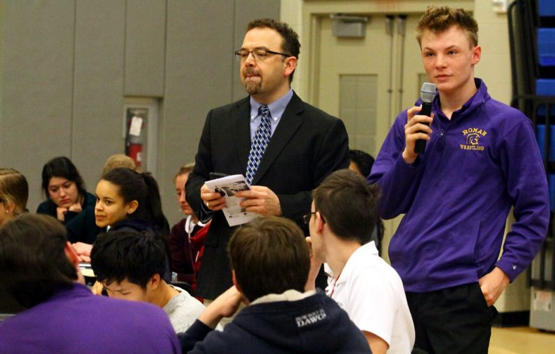 Roman Catholic High School junior Mike Petrucci (right) shares what his group discussed during group sessions, along with the day's program leader, Joseph Aquilante of Bishop Shanahan High School in Downingtown.
