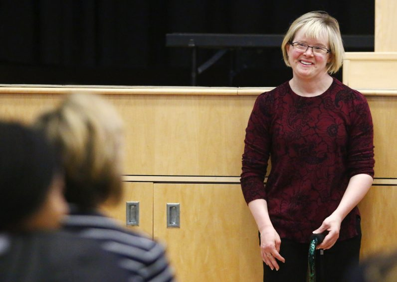 Karen Gaffney, who has a long list of accomplishments, speaks with students about respect for people like her with Down syndrome, and any disability.