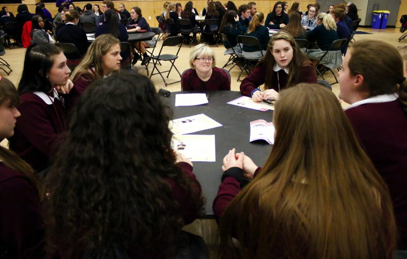 Dr. Karen Gaffney (center) works in small groups with students discussing topics during the High School Respect Life Conference and Rally April 6 at Neumann University.