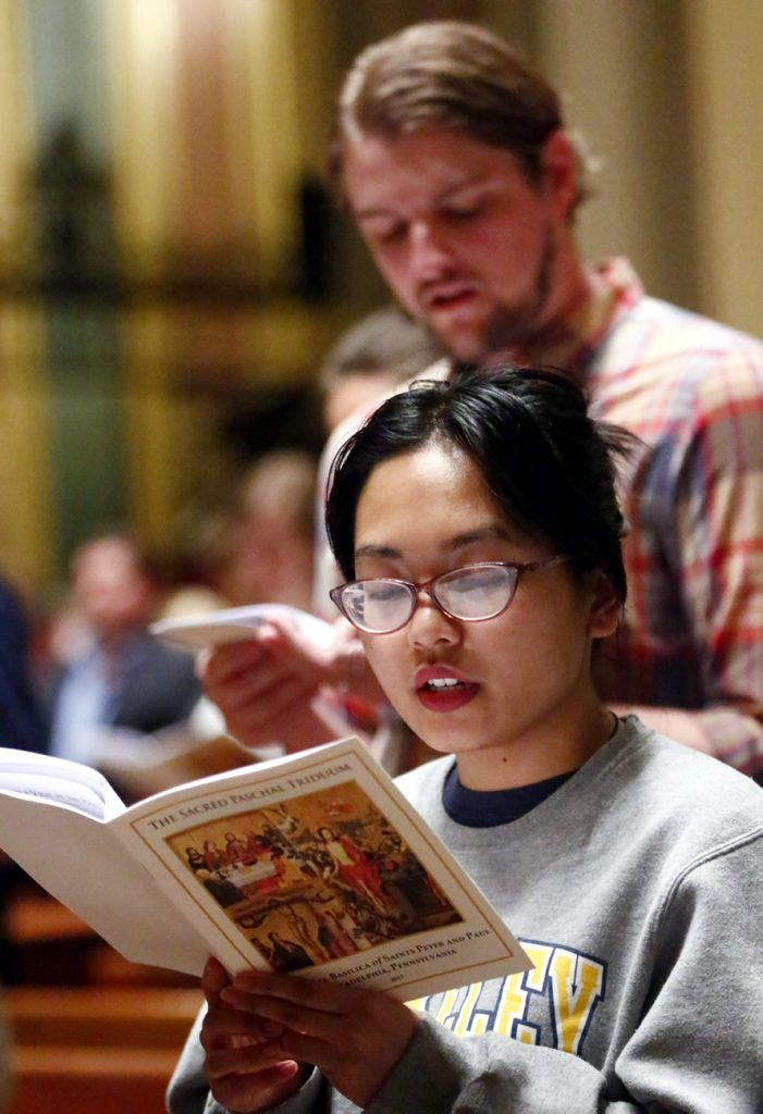 Mary Ramos from St. Agatha-St. James Parish attend the Mass of the Lord's Supper on Holy Thursday, April 13 at the Cathedral Basilica of SS. Peter and Paul.