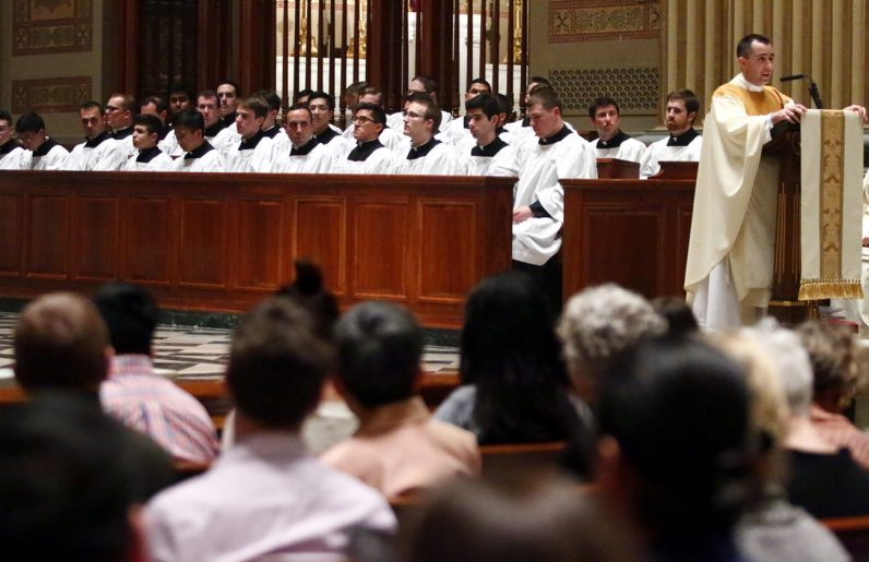 Father Thomas Viviano preaches the homily at the Cathedral Basilica of SS. Peter and Paul for the Mass of the Lord's Supper.