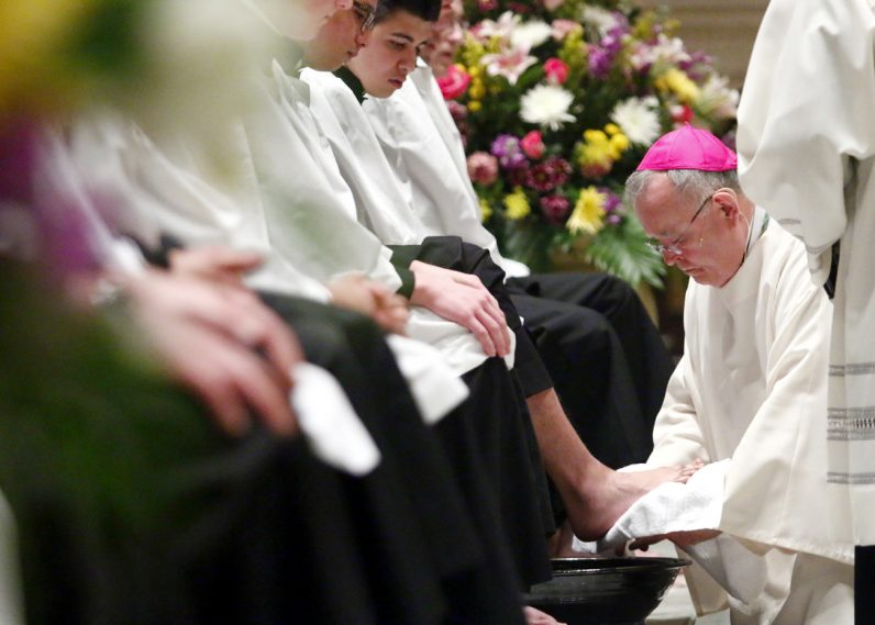In imitation of Jesus at the last supper, Archbishop Charles Chaput washes the feet of 12 seminarians from St. Charles Borromeo Seminary on Holy Thursday, April 13 at the Cathedral Basilica of SS. Peter and Paul.