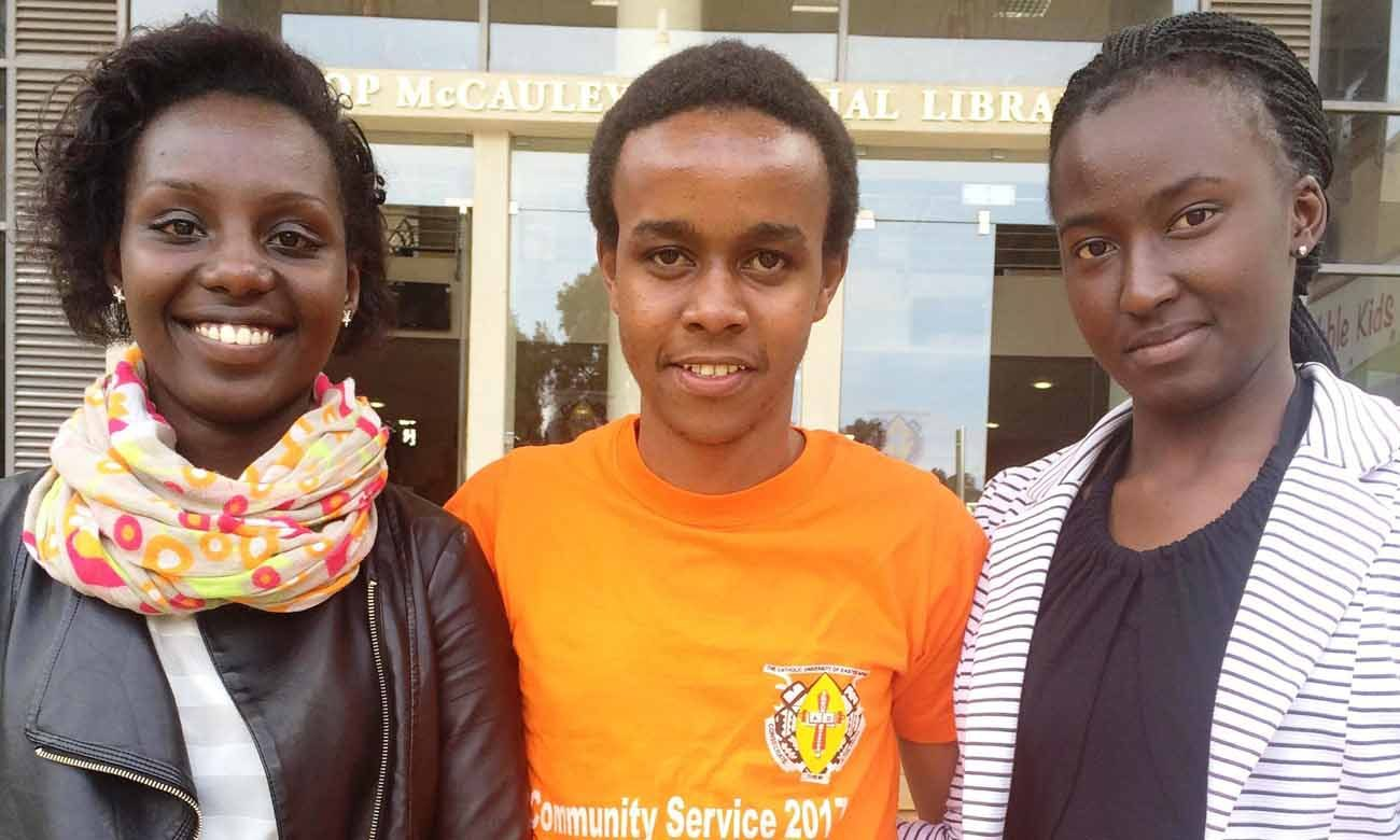 Karen Rono, Nelson Ng'ang'a and Betty Amutabi, students at the Catholic University of Eastern African in Nairobi, Kenya, pose for an April 12 photo on the campus. (CNS photo/Francis Njuguna) 7.