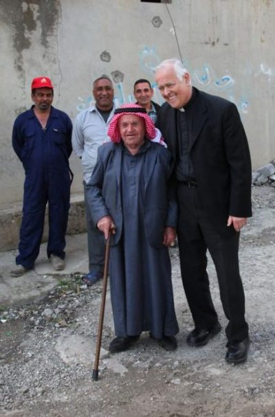 Msgr. John E. Kozar, president of the Catholic Near East Welfare Association, poses with a villager April 2 in Batnaya, Iraq. Msgr. Kozar was on a March 31-April 5 pastoral visit to Iraq. (CNS photo/courtesy John E. Kozar, CNEWA)