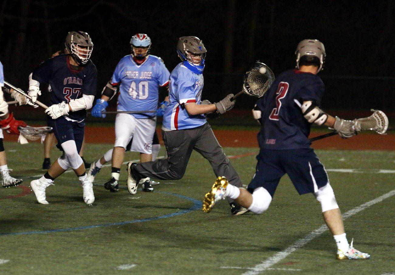 A Father Judge player attacks the Cardinal O'Hara zone during lacrosse action Monday, April 3 at O'Hara. (Sarah Webb)
