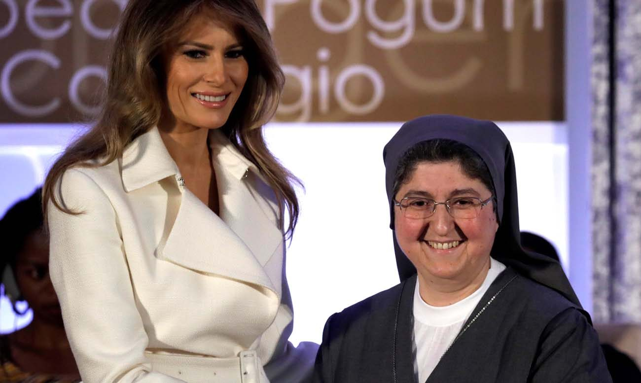 First lady Melania Trump presents Sister Carolin Tahhan Fachakh of Syria with the 2017 Secretary of State's International Women of Courage Award during an award ceremony at the State Department in Washington in this March 29, 2017. Sister Tahhan Fachakh is a member of the Daughters of Mary Help of Christians. (CNS photo/Kevin Lamarque, Reuters)