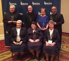 Bishop Michael Fitzgerald, top row second from left, poses with the six recipients from the Philadelphia Archdiocese of the NCEA's Lead Learn Proclaim Awards April 19 in St. Louis. They include (top row from left) Father Joseph Maloney, pastor of St. Aloysius Parish in Pottstown; Bishop Fitzgerald; Father Stephen Thorne, pastor of St. Martin de Porres Parish in Philadelphia and chaplain for Neumann University; and Audrey Neil, Kindergarten teacher at St. Dorothy School, Drexel Hill. Bottom row, from left: Sister Stephen Anne Rodriguez, I.H.M., principal of St. Aloysius Academy for Boys, Bryn Mawr; Sister Edward William Quinn, I.H.M., director of curriculum and instruction, Office of Catholic Education; and Sister Rita Murphy, I.H.M., principal of St. Rose of Lima School, Philadelphia.