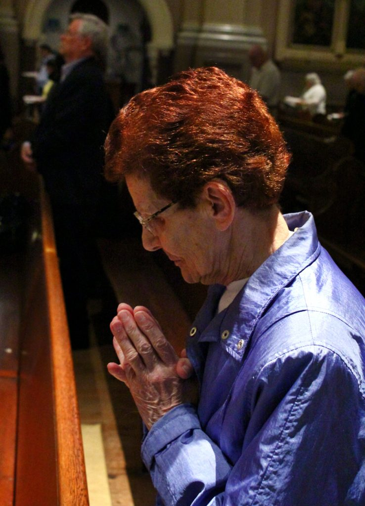 Yolanda Mockus prays during Mass at Nativity B.V.M. Church in Philadelphia's Port Richmond section.