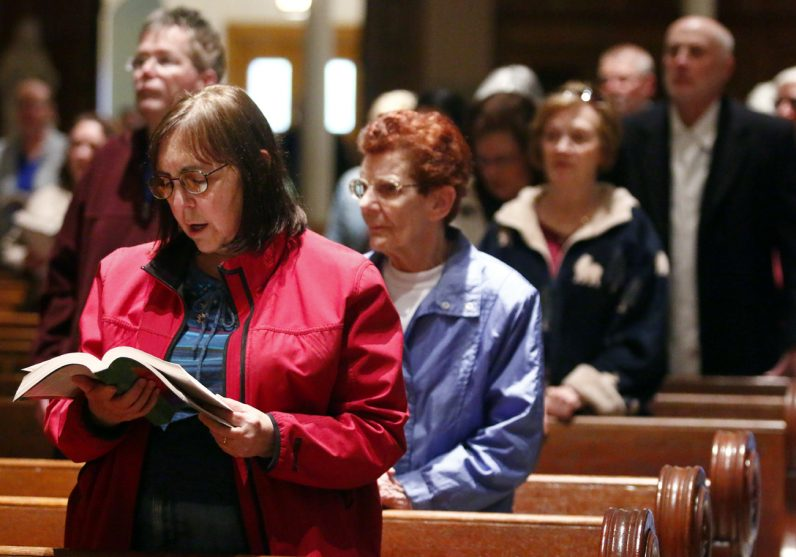 Diane Knackstedt sings during Mass on Holy Thursday, April 13 at Nativity B.V.M. Church.