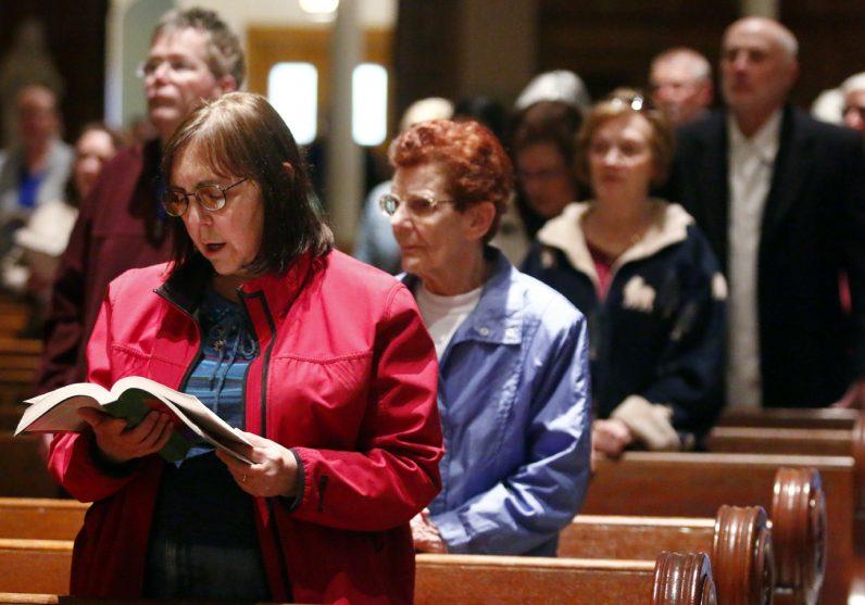 Diane Knackstedt sings during Mass on Holy Thursday, April 13 at Nativity B.V.M. Church.