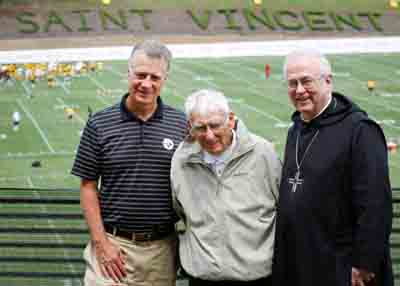 Dan Rooney, chairman of the Pittsburgh Steelers, center, Arthur J. Rooney II, president of the Steelers, and Benedictine Archabbot Douglas R. Nowicki, chancellor of St. Vincent College, pose for a 2013 photo at the NFL team's football training camp on the college campus in Latrobe, Pa.  (CNS photo/Bob Roller)