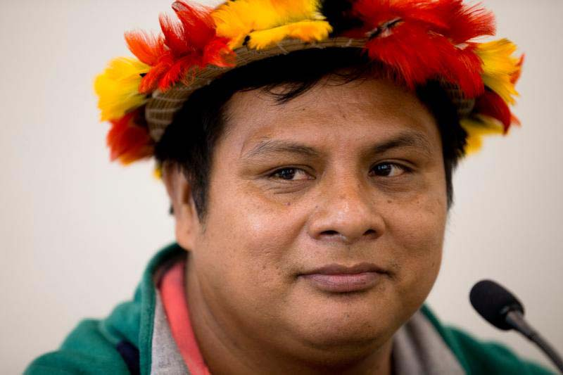 Zebelio Kayap Jempekit, an Awajun leader in northern Peru, is seen in Washington March 21. He described the fouling of rivers -- his people's only source of water for drinking, cooking and bathing -- because of mining and oil operations. (CNS photo/Tyler Orsburn)