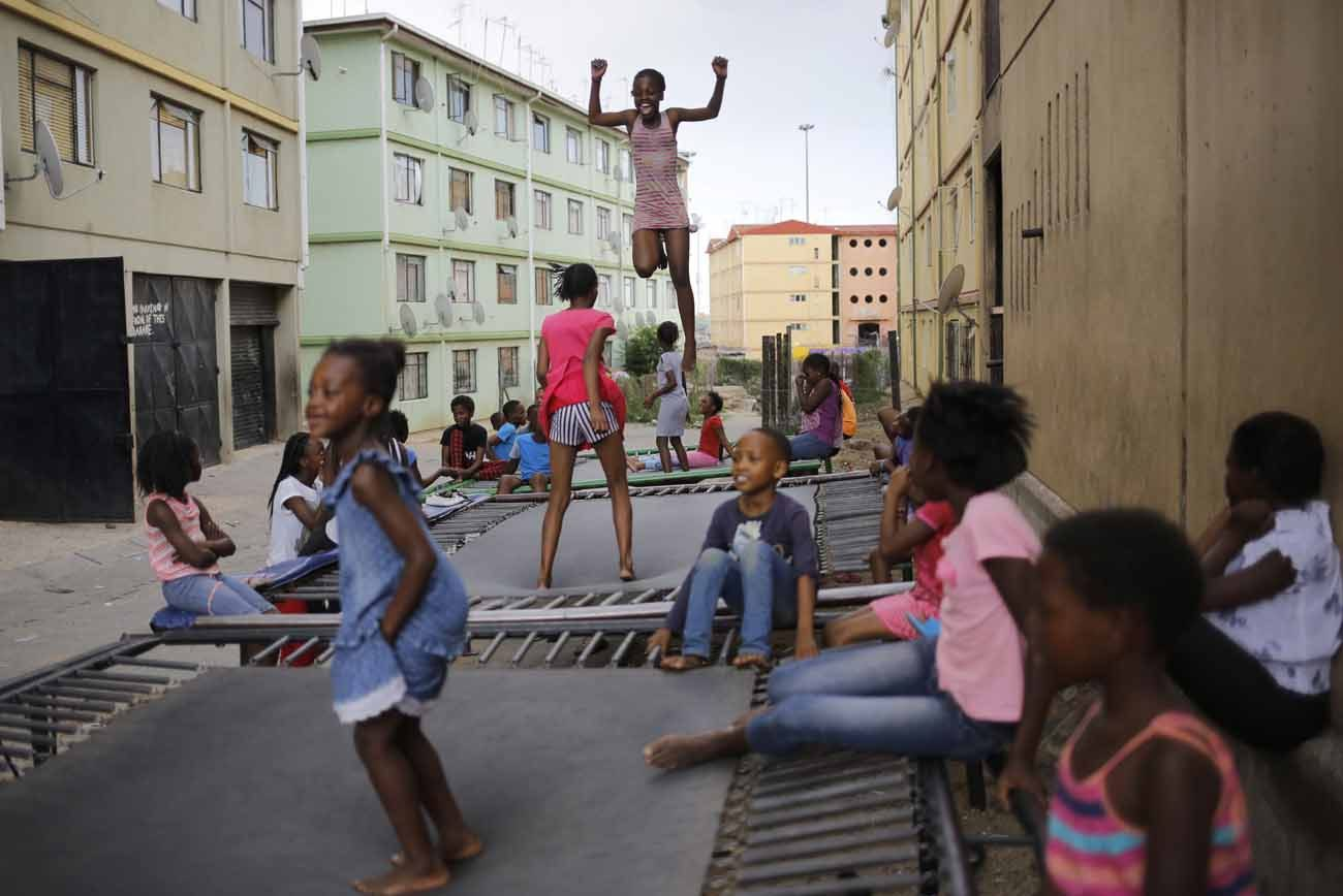 Children jump on a trampolines in 2016 in Johannesburg. Most of Christianity's future growth is likely to be in the global South, particularly in sub-Saharan Africa, where the Christian population is relatively young, according to a new Pew Research Center analysis. (CNS photo/Kim Ludbrook, EPA)