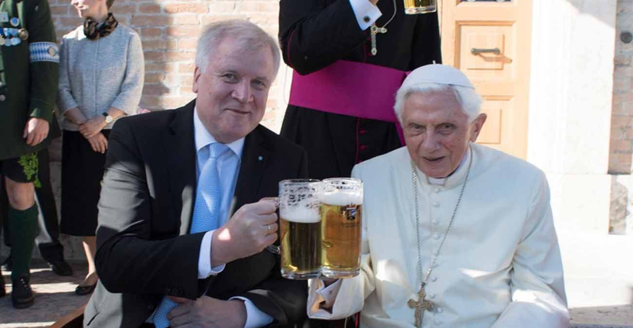 Retired Pope Benedict XVI raises a glass of beer with Bavarian Prime Minister Horst Seehofer during the German pontiff's 90th birthday celebration April 17 at the Vatican. (CNS photo/L'Osservatore Romano)