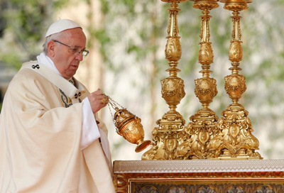 Pope Francis uses incense as he celebrates Easter Mass in St. Peter's Square at the Vatican April 16. (CNS photo/Paul Haring)