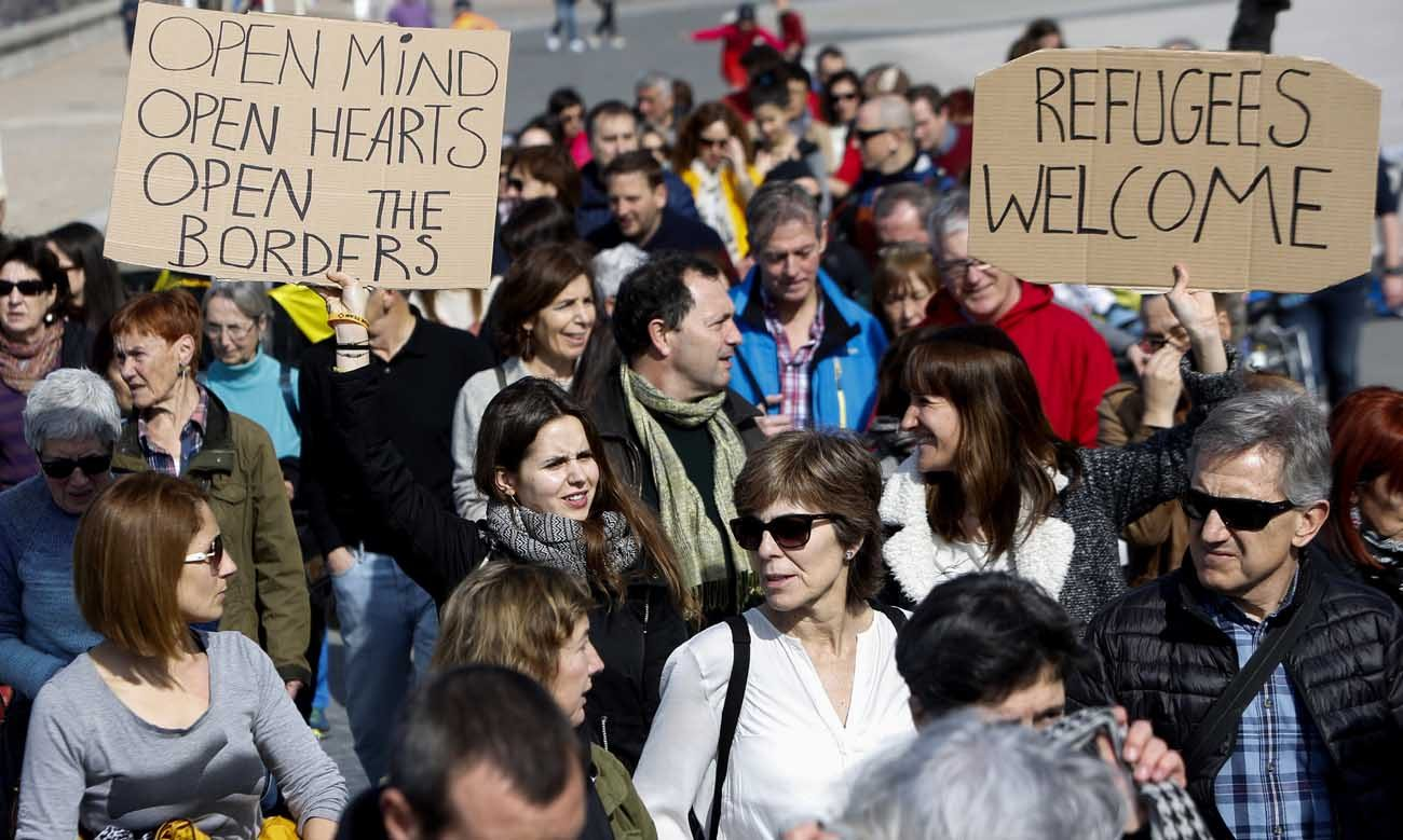 People take part in a Feb. 26 march to support refugees in San Sebastian, Spain. Members of the Catholic Church have an obligation to recognize the value of welcoming newcomers, Pope Francis said. (CNS photo/Javier Etxezarreta, EPA)