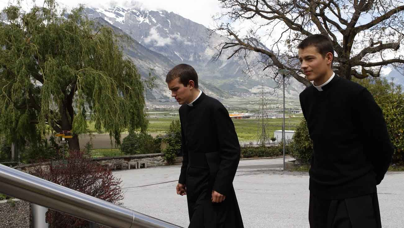 Seminarians walk on the grounds of the Society of St. Pius X seminary in Econe, Switzerland, in this May 9, 2012, file photo.  Continuing initiatives aimed at a reconciliation with the Priestly Society of St. Pius X, Pope Francis has made it possible for bishops to ensure the validity of marriages celebrated in the traditionalist communities. (CNS photo/Paul Haring)