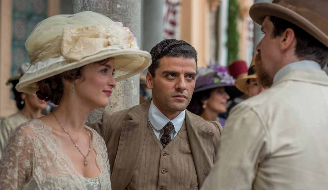 "Charlotte Le Bon, Oscar Isaac and Christian Bale star in a scene from the movie ""The Promise."" (CNS photo/Open Road Films)"