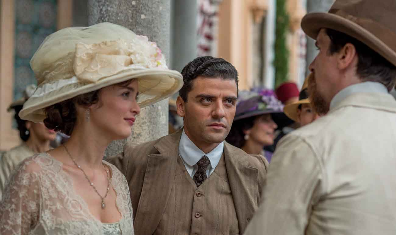 "Charlotte Le Bon, Oscar Isaac and Christian Bale star in a scene from the movie ""The Promise."" The film dramatizes the genocide of Armenians in the Turkish-ruled Ottoman Empire at the outset of World War I. (CNS photo/Open Road Films)"