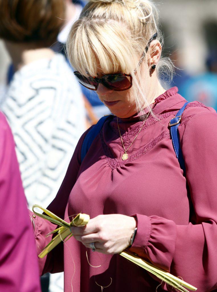 Patti Conrad, from St. Paul Parish in Burlington, N.J., folds her palm into a cross.