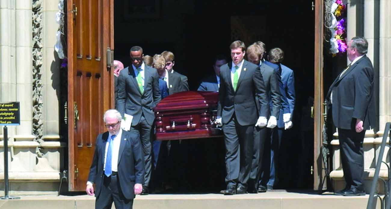 Pallbearers carry the casket of Daniel Rooney, chairman of the Pittsburgh Steelers, after his funeral Mass at St. Paul Cathedral in Pittsburgh April 17. (CNS photo/Chuck Austin, Pittsburgh Catholic)