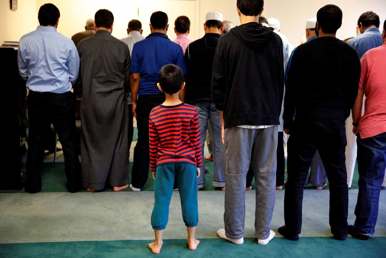 A boy attends afternoon prayer in 2016 at a mosque in Sterling, Va. A new update to a 2016 study on Catholic perceptions of Islam shows, like the initial survey, that three in 10 Catholics admit to having unfavorable views about Muslims. (CNS photo/Carlos Barria, Reuters)
