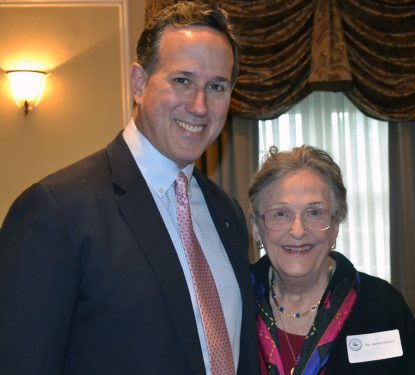 Former Sen. Rick Santorum poses with Barbara Henkels April 25 at an event benefiting Regina Angelorum Academy, which Henkels and her late husband, Paul, helped to found.