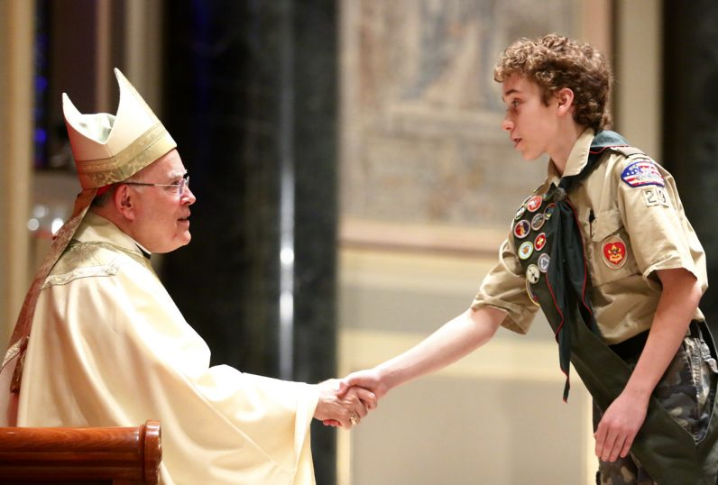 Matthew Simms from Troop 29 receives the Ad Altare Dei Award.