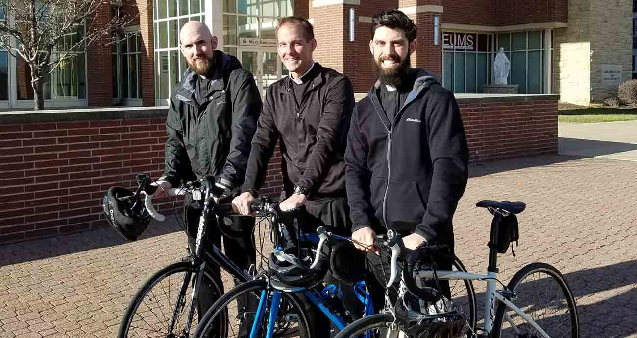 """Three priests from the Diocese of Peoria, Ill., plan to ride their bicycles across the diocese, a trek of 350 miles, from April 24-28 to inspire prayers for vocations. The """"Priests Pedaling for Prayers"""" are Fathers Tom Otto, Adam Cesarek, and Michael Pica. (CNS photo/courtesy Diocese of Peoria's Office of Priestly Vocations)"""